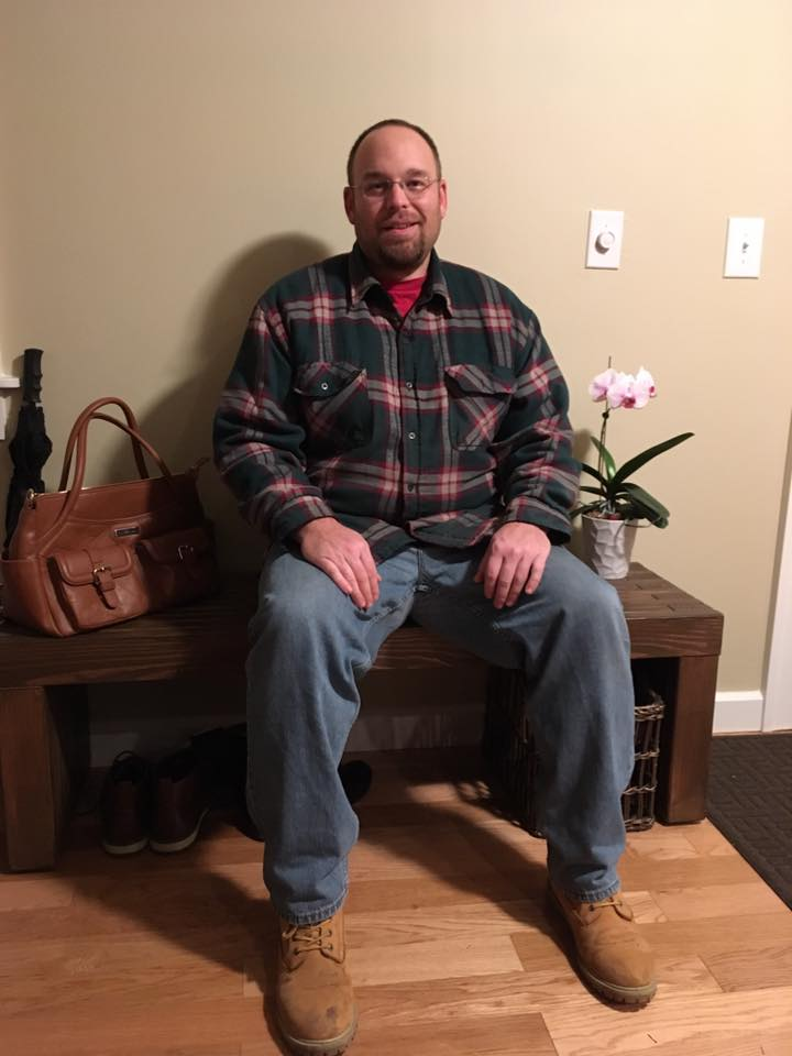Joe B sitting on the entryway bench.